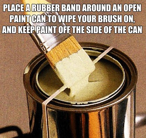 place a rubber band around an open paint can to wipe your brush on and keep the paint off the side of the can, life hack