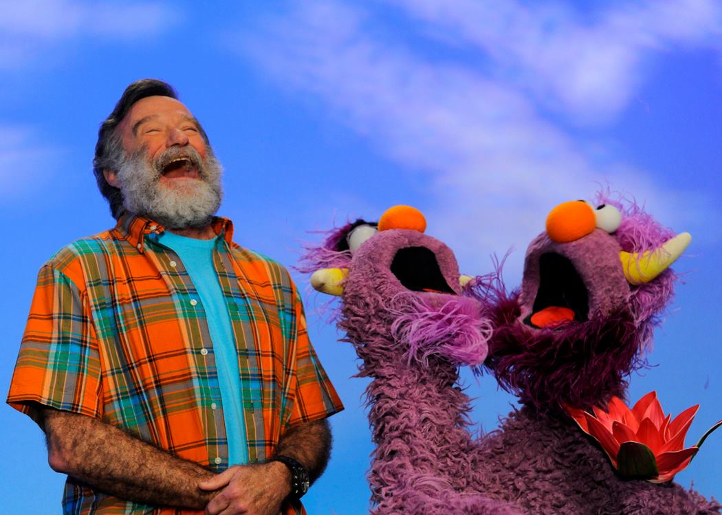 robin williams laughing with muppets