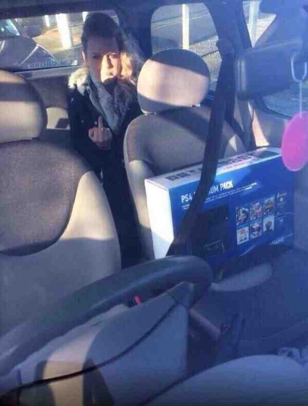 girlfriend is not happy that the ps4 gets shotgun, middle finger