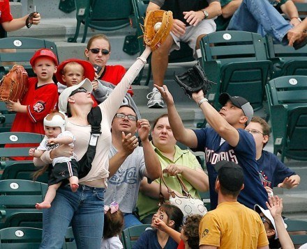 'murica, mother catches baseball while holding baby in other hand