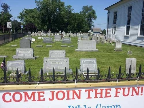 come join the fun, sign in front of a cemetery