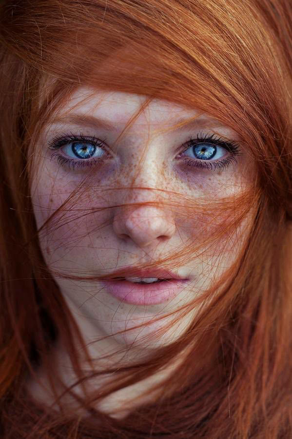 freckled redhead with blue eyes