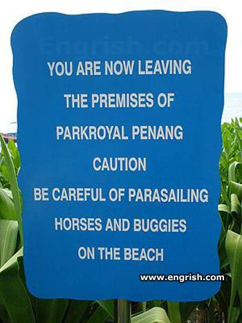 caution be careful of parasailing horses and buggies on the beach