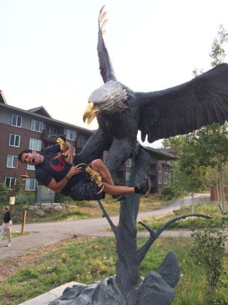 scary statue irl, eagle attacking man