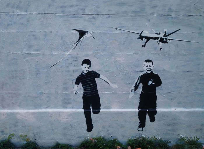 the latest banksy piece, kid flying a kite, kid running from a drone