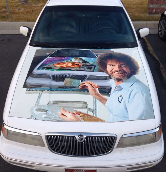 bob ross painting on a car hood of a painting of a space pizza cat on a car hood