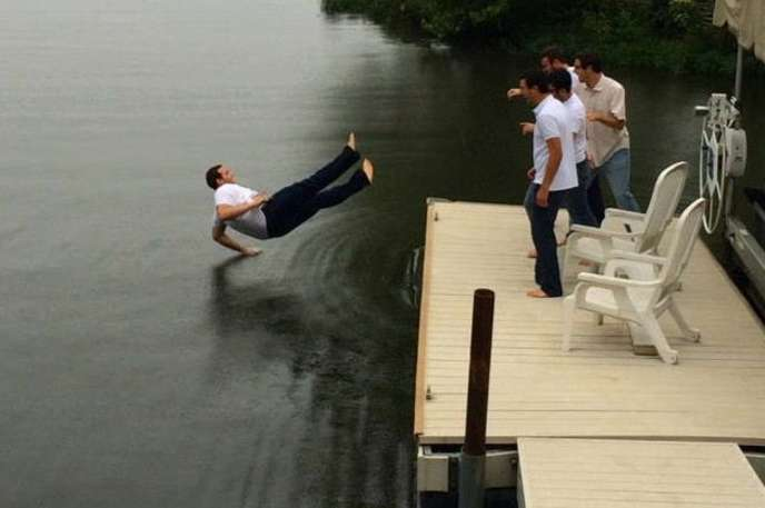 perfectly timed photo of a guy falling onto water