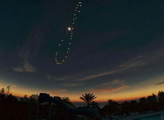 the sun photographed from the same location over the course of one year.