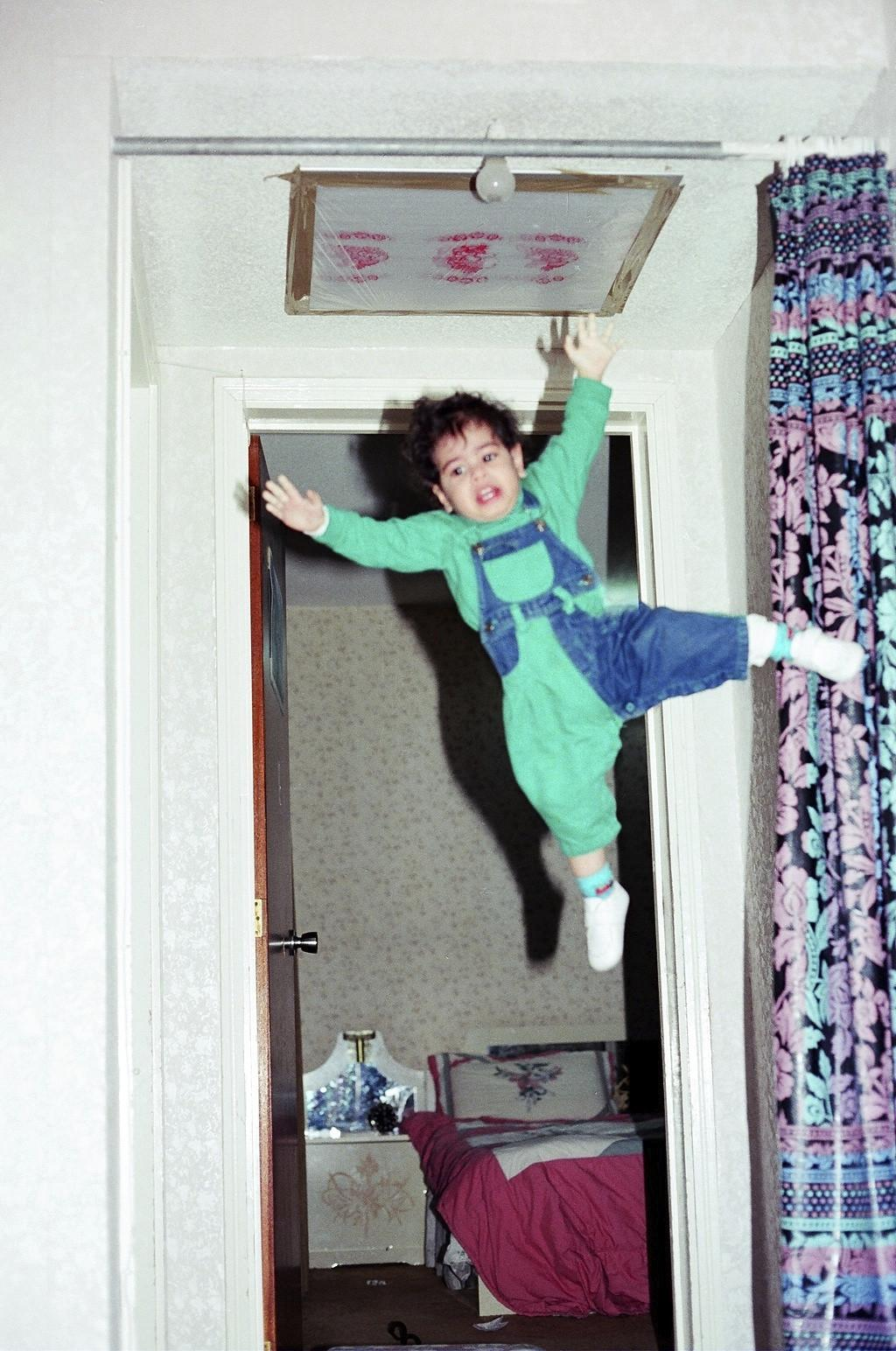 my dad thought 2-year-old me was strong enough to hang from the curtain rod while he takes a picture, timing, fail, lol