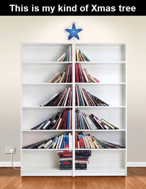 this is my kind of christmas tree, books in a book shelf look like a christmas tree