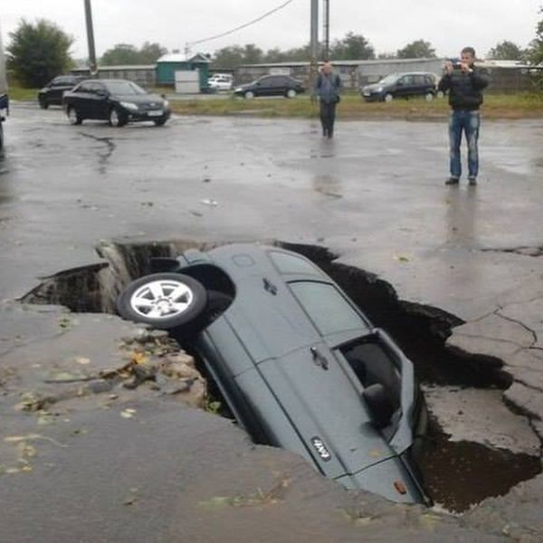 when parking your car goes horribly wrong, sink hole in the road