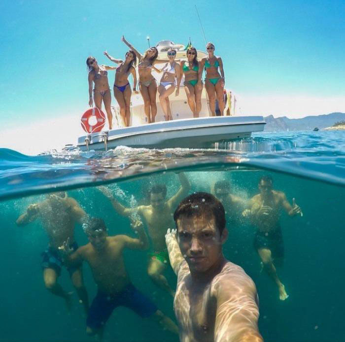 best group selfie ever, girls in bikinis on boat and guys underwater