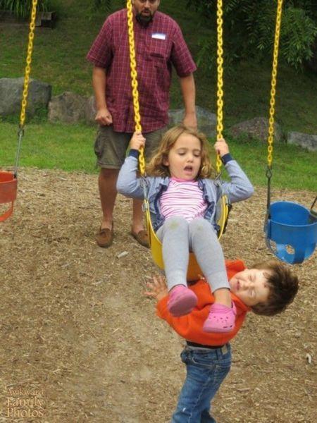 little girl kicks boy while on swing, timing