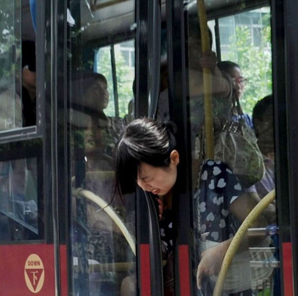 getting on the bus is a real challenge for some people, girl with head stuck in bus doors