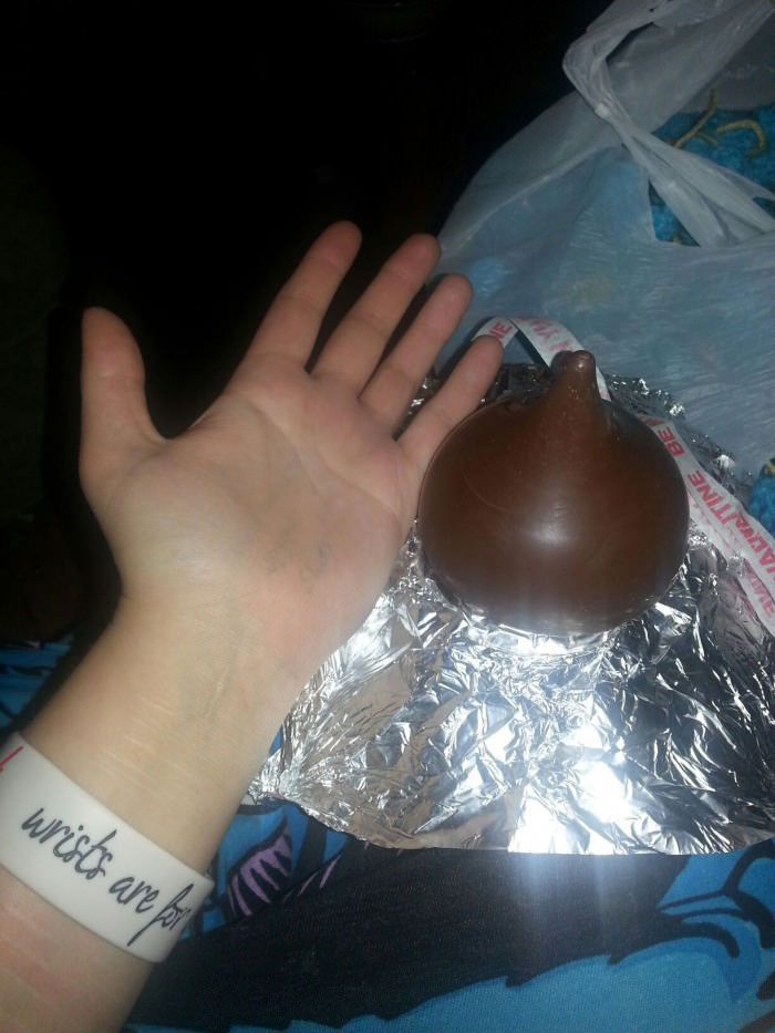 just a really big hershey kiss with my hand for size reference