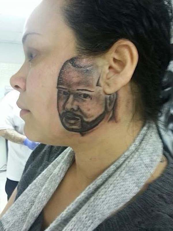 worst tattoo ever, face on the side of her face