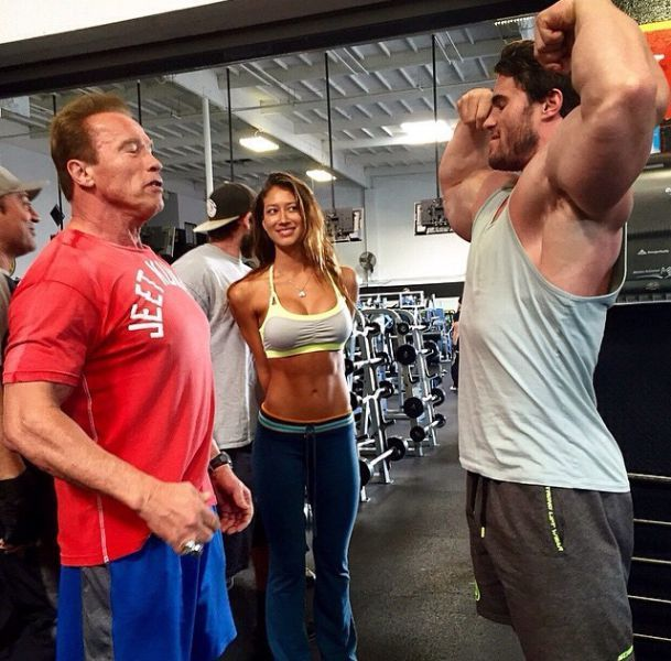 flexing your muscles in front of arnold schwarzenegger