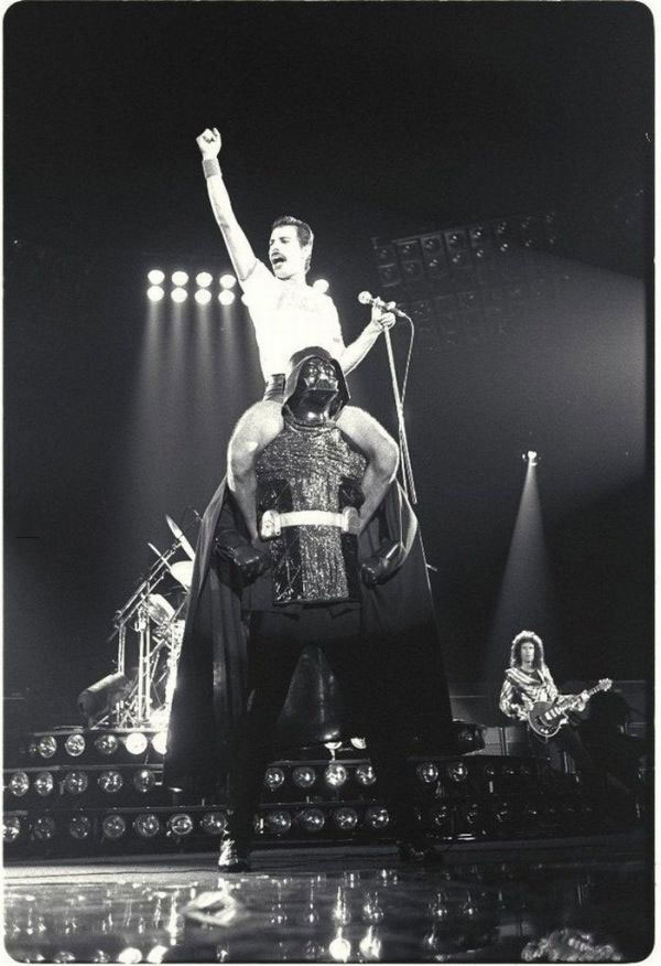 just a picture of freddie mercury on darth vader's shoulders during a queen concert
