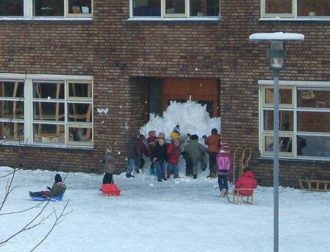 this is how i remember child hood, kids pile tons of snow in front of school doors