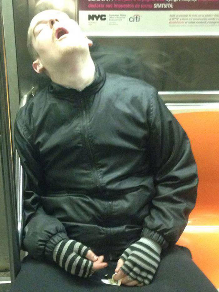 just a guy who feel asleep on public transport while rolling a joint