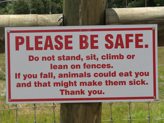 please be safe, if you fall the animals could eat you and that might make them sick, thank you, sign, lol