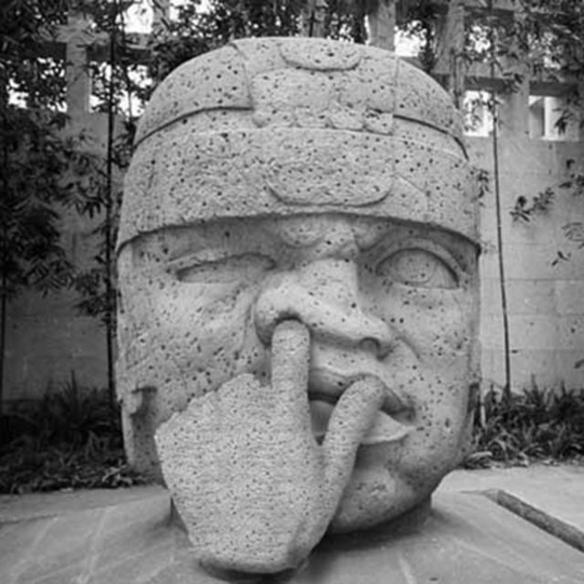 just an actual stone face sculpture of a guy picking his nose