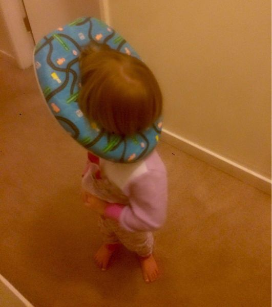 kid with head stuck in toilet seat cover