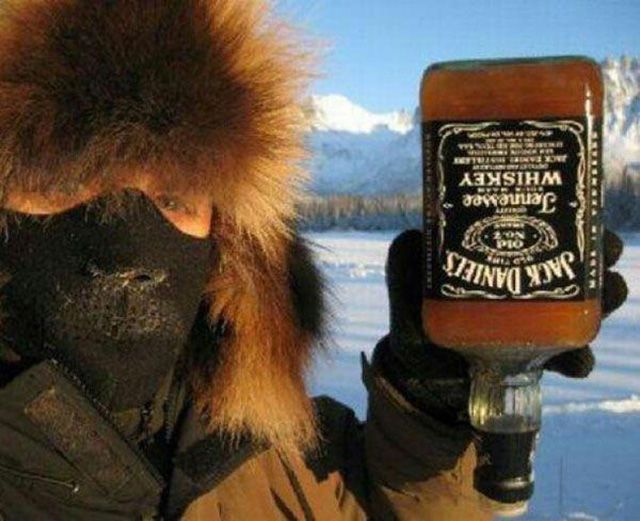 you know it's too damn cold outside when.... frozen bottle of jack daniels
