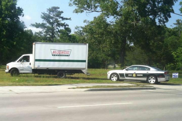 when a cop just can't help himself, police car pulled over krispy kreme