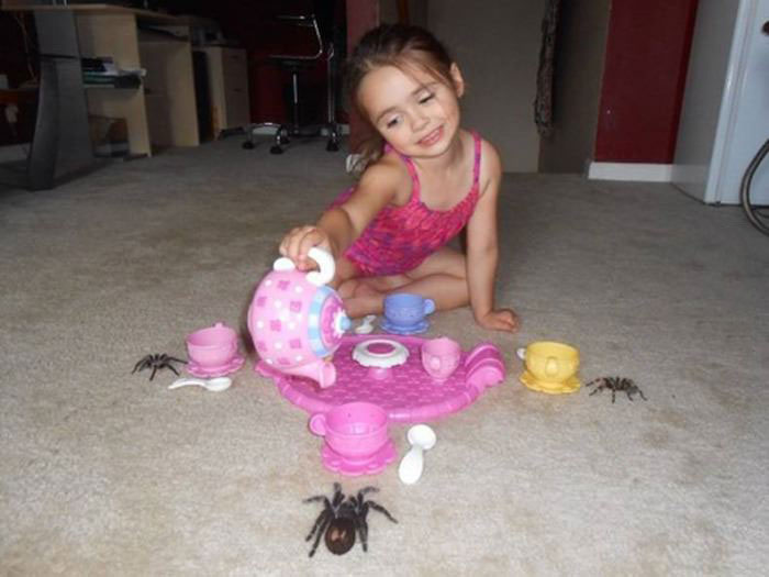 just your average tea party with a little girl and her friend spiders