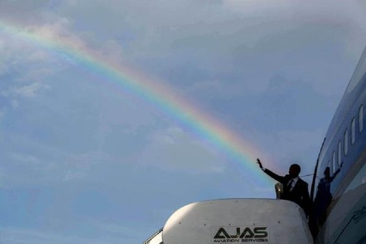 white house tweets picture of obama shooting rainbow from raised hand