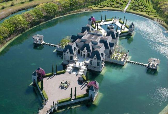 house built inside an oval artificial lake