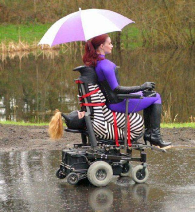 woman in purple ones riding wheelchair of bondage, wtf