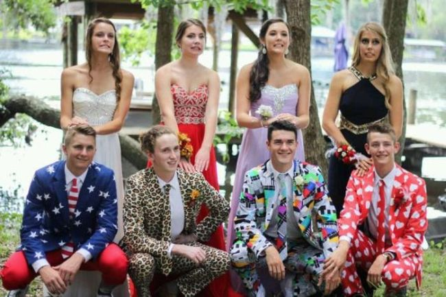 a group of girls in nice dresses and guys in ridiculously ugly suits
