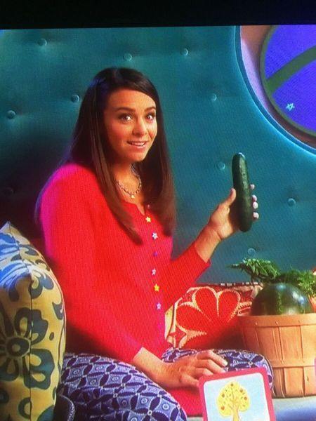just a girl posing with her cucumber