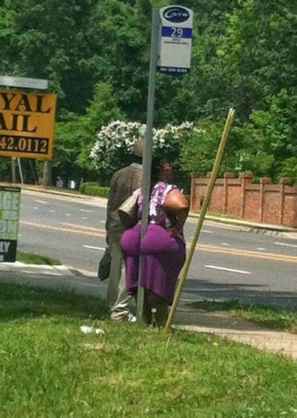 worst way to rest on a poll ever, butt cheeks surround sign post, fat ass, wtf