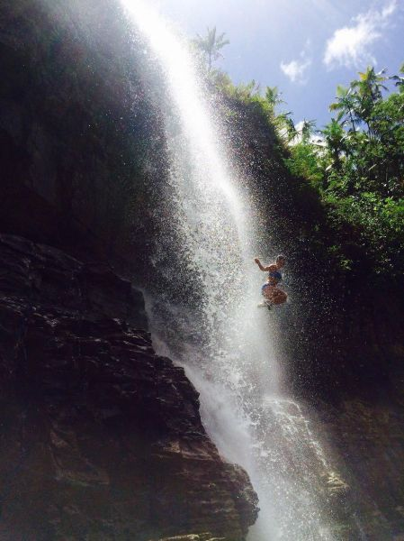 jumping off a water fall cliff, timing, beautiful photograph