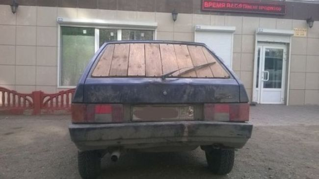 car with a wooden rear view window