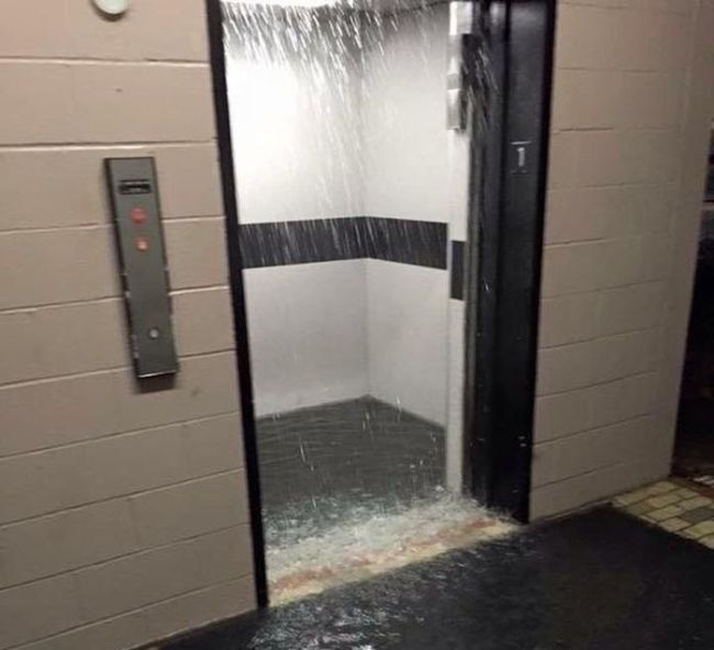 hey look it's one of those aqualevators, water pouring down from ceiling of elevator