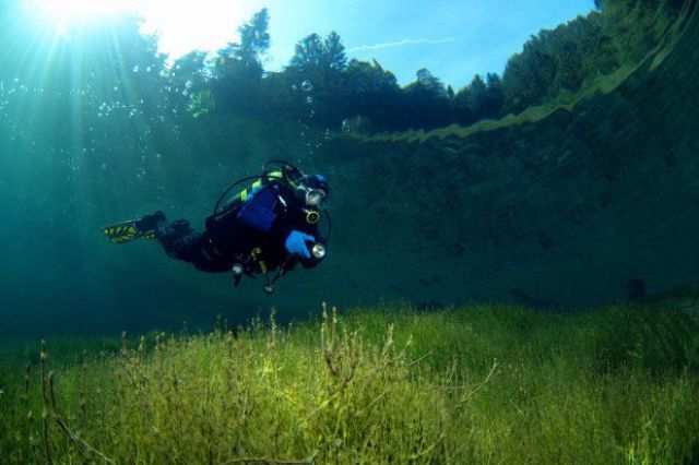 scuba diving in a crystal clear lake