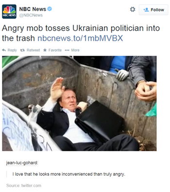 angry mob tosses ukrainian politician into the trash, i love how he looks more inconvenienced than truly angry