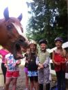 horse photobombs group of little girls