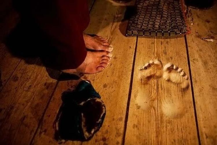a monk prayed for 12 years in the same spot and left this footprint in wood