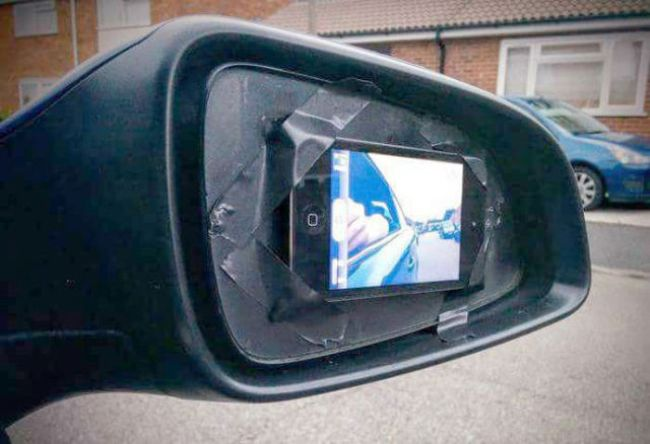 because replacing the side mirror is too complicated, iphone in front camera mode as car's side mirror