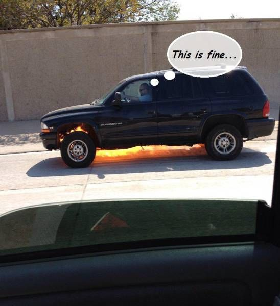 guy driving down the road in his on fire sub, this is fine