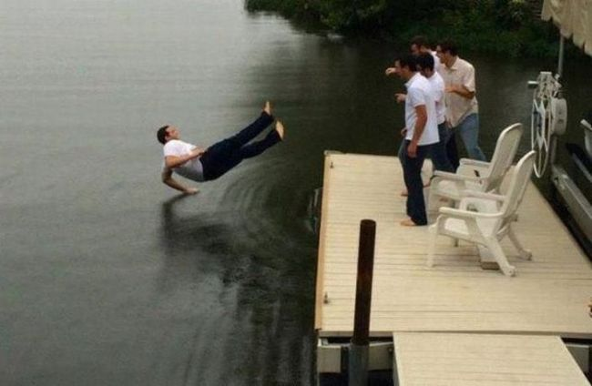 perfectly timed photo of man being pushed onto water, hand just at threshold, timing