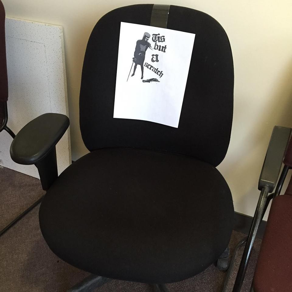 tis but a scratch, one arm office chair gets a monty python reference