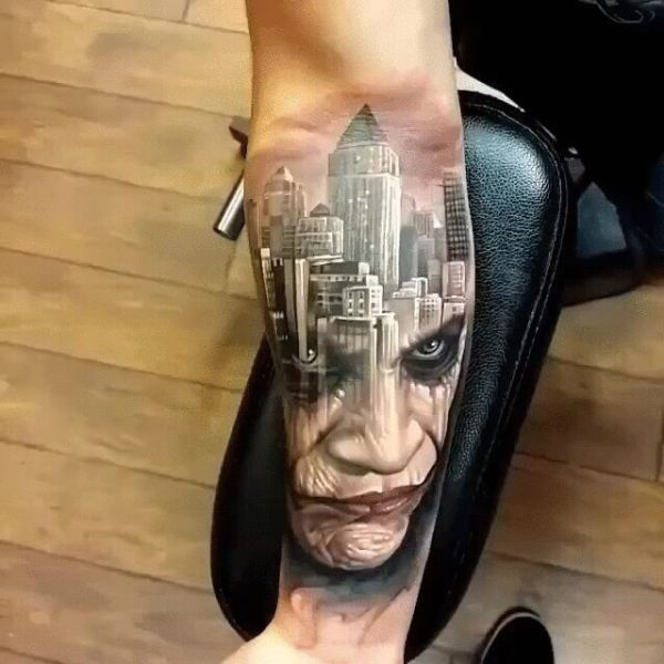 really cool face and city tattoo on forearm