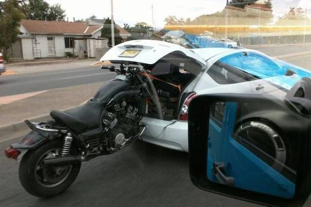 motorcycle in car trunk, fail