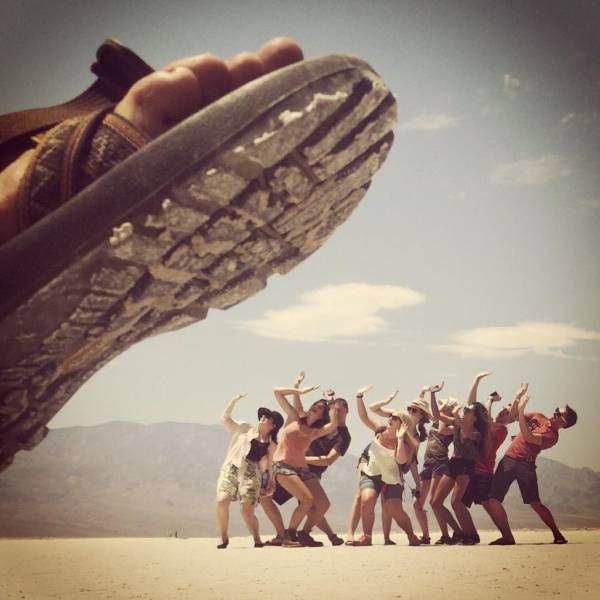 giant flip flop about to crush people in the desert, perspective